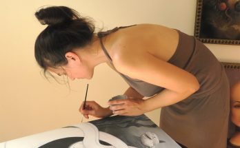 Sabina Nore, working on a painting-in-progress