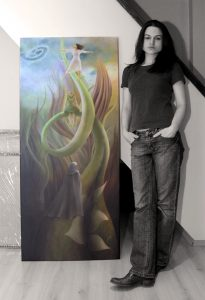 Sabina Nore, next to her painting Reaching